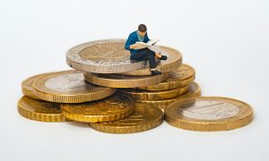 Man sitting on Coins